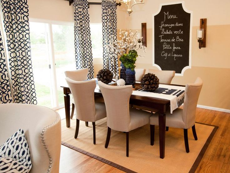 In This Open Plan Neutral Dining Room A Whimsical Chalkboard On The Wall Provides