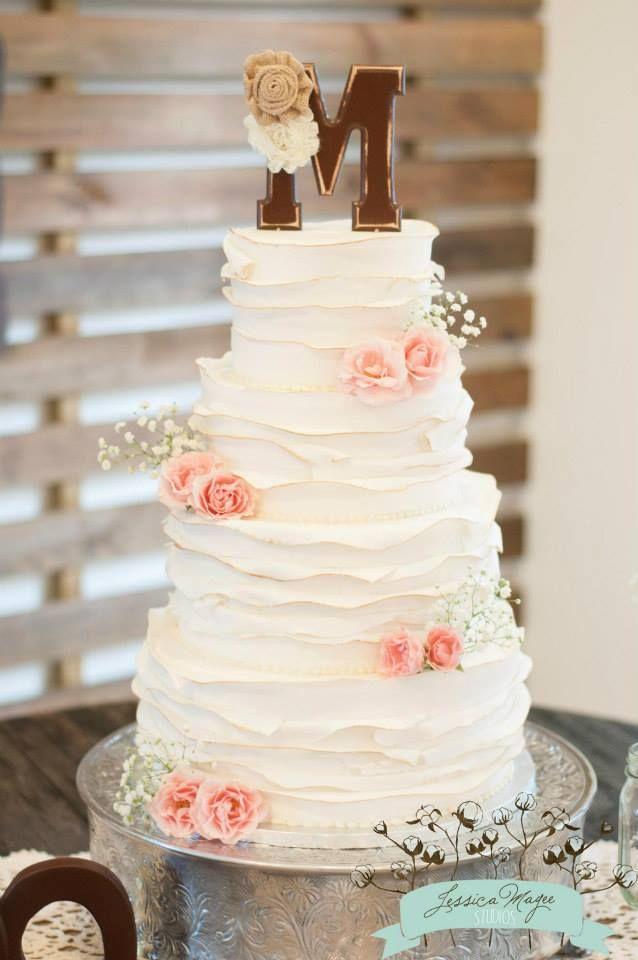 Rustic Ruffle Wedding Cake On Wooden Stand