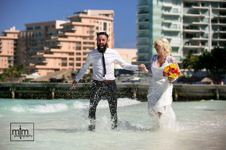 Groom Garret (a doppleganger for Conor McGregor of UFC) is seen here frolicking in the Mexican surf with his new wife, Lyndsey at their #RiuCancun newlywed photo shoot captured by #MTMPhotography - Enjoy!