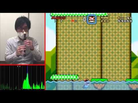 Man plays Super Mario World with his nose! Using a recorder and a program called Audio Pad which translates sounds into controls, he plays SMB World.