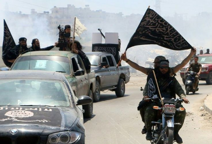 The spokesman for Al-Qaeda's Syrian affiliate, Al-Nusra Front, his son and 20 other jihadists were killed in air strikes Sunday in the northeast of the country, a monitor said.