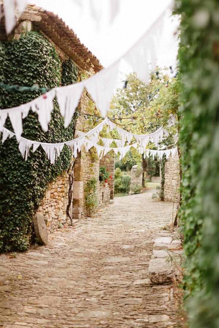 #Bunting | On #SMP Weddings: http://www.StyleMePretty.com/2014/01/06/le-grand-banc-provence-wedding/ | Xavier Navarro Photography