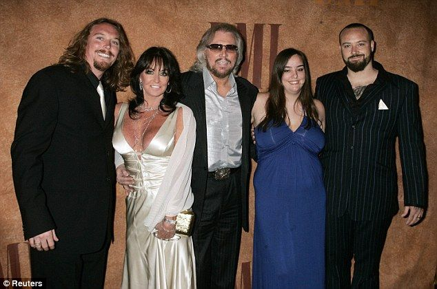 barry gibb and his family | Family: Barry (centre) and his wife Linda (centre left) pose with ...