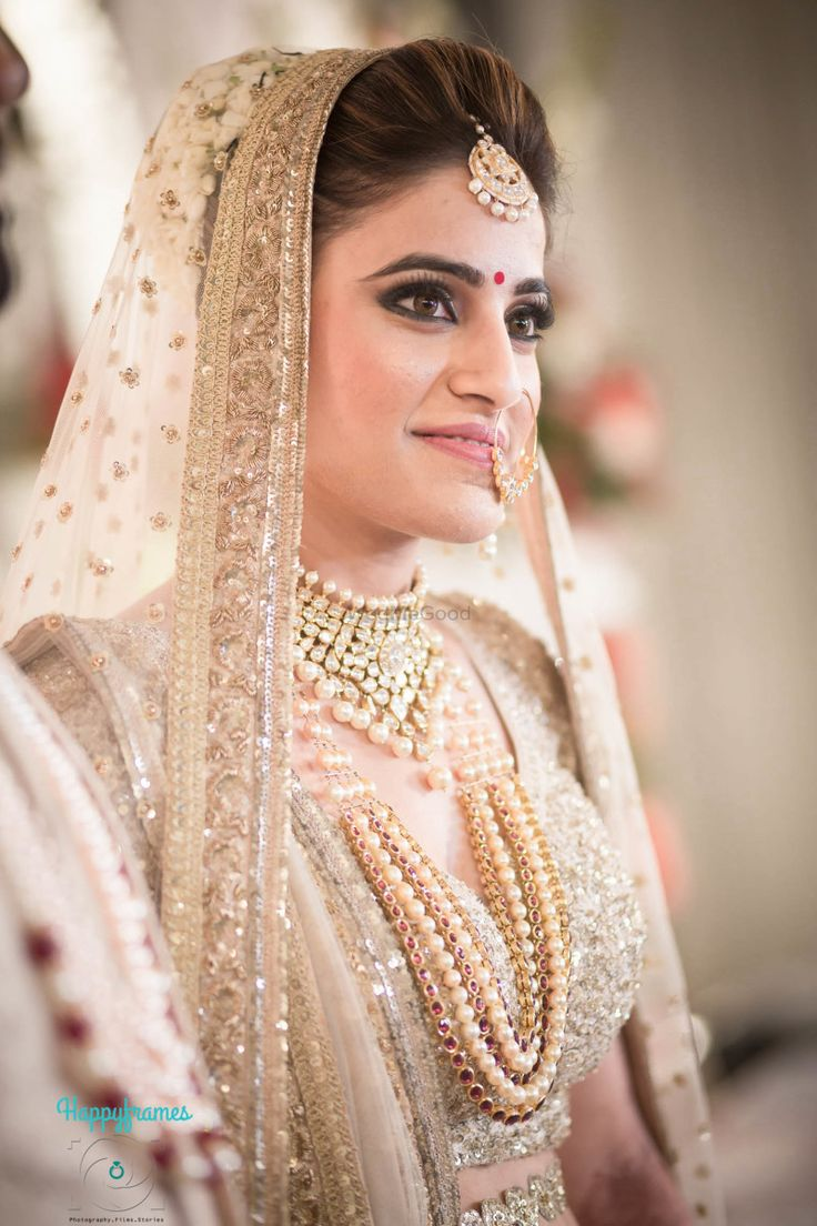 Bride- Portrait - Gold Bridal Lehenga with a Polki and Pearl Choker | WedMeGood #wedmegood #indianbride #indianwedding #bridalportrait #bridal #weddingportrait #gold #sequinnedlehenga