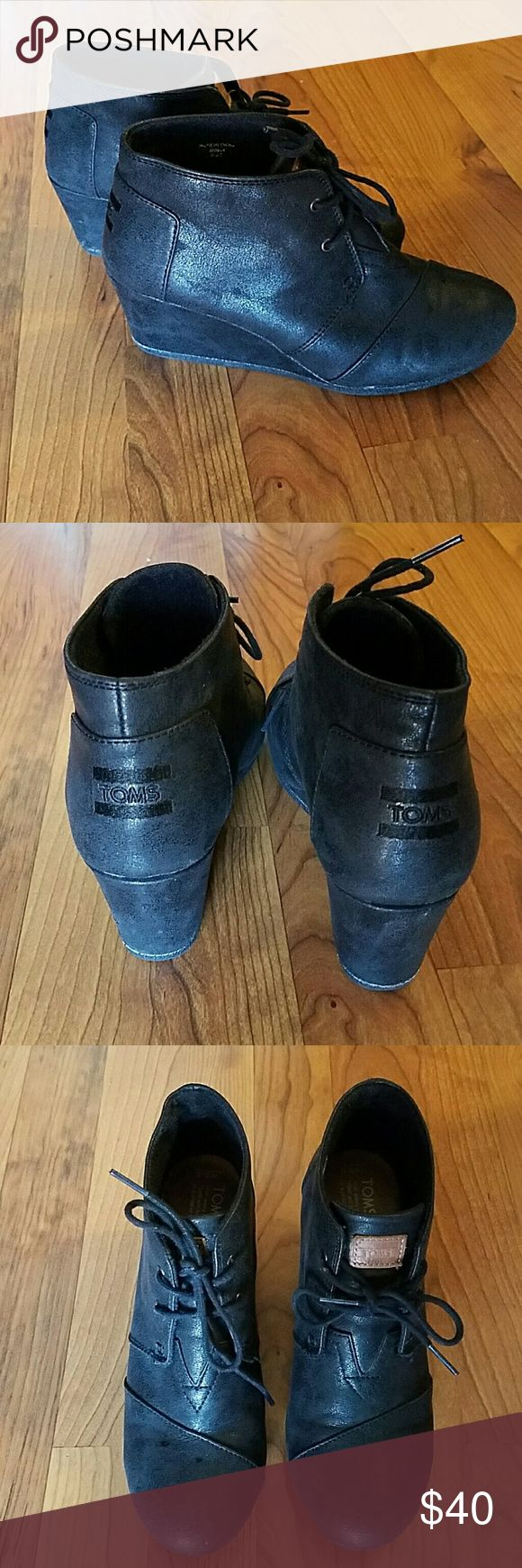 Toms Black Wedge Booties Size 8.5 Toms Black Wedge booties sz 8.5. Solid black, lace up front, toms logo on back and front flap. Super cute! TOMS Shoes Ankle Boots & Booties
