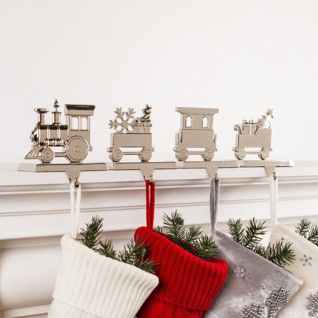 Hang your stockings by the chimney with care without harming your fireplace mantle. This set of four weighted stocking holders sits atop your mantle and lets you display your stockings in preparation for St. Nick's arrival.