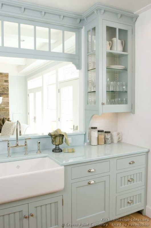 The Everyday Home: Open Kitchen Shelving. Such a beautiful color of soft blue for a kitchen, love the transom window above the opening and the details at the crown