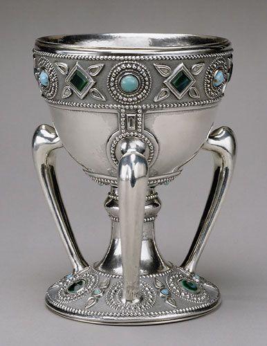 Three-handled cup (tyg), ca. 1905  Louis Comfort Tiffany (1848–1933), Tiffany Studios (1902–1938)  Silver, glass, 8 x 6 in. (20.3 x 15.2 cm)  Stamped: (on underside) TIFFANY STUDIOS/NEW YORK./ STERLING/925/1000/4787.  The Metropolitan Museum of Art, New York, Purchase, The Edgar J. Kaufmann Foundation Gift, 1969 (69.36)   JV