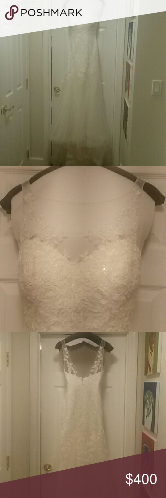 """David's Bridal Illusion wedding dress size 4/6 Style # MK3718 Purchased as a size 6 and took it in at the tummy area. My ribcage is a 6, but my waistline is a 4. I'm normally a David's Bridal bridesmaid dress size 4...In heels I was  5' 8"""" and the dress still drapes the ground. I also had a bustle installed, hook & eye system. Professional cleaned. Will ship in it's dress bag. Smoke free home. Can also include floor length veil. For sale cheaper on preownedweddingdresses.com Listing ID…"""