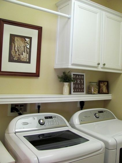 "Laundry room ideas - cabinet, shelf, and hanging rod. I like this b/c it still allows the dryer vent area ""air"" so it doesn't get too hot (house fires)."