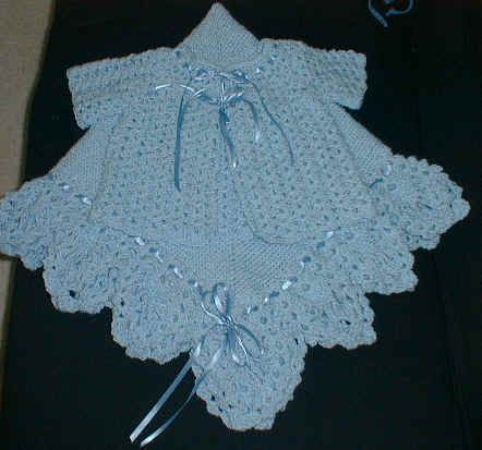 A charming sacque, bonnet and bootie set will warm the wee one in your life.