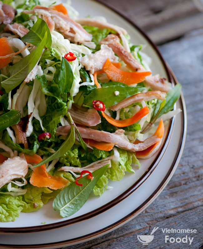 Vietnamese Chicken Salad Recipe (Gỏi Gà) can be especially pleasing with different textures and flavors ranging from fried shallots, roasted peanuts, fried garlic and picked onions to different Vietnamese herbs such as mint, basil or the classic rau ram. #salad #vietnamesesalad #vietnamesefood