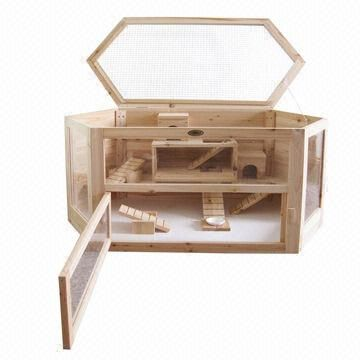 wooden cage/habitat with top and side openings.