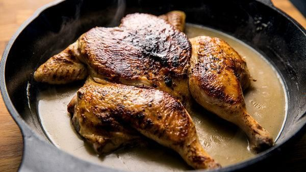 What's better than a whole chicken , split down the middle, seared in a buttery skillet, then cooked in its own gravy? Not a lot. Here, Sam Sifton of The New York Times demonstrates a classic smothered, spatchcocked chicken recipe courtesy of the late, renowned Times critic Craig Claiborne.