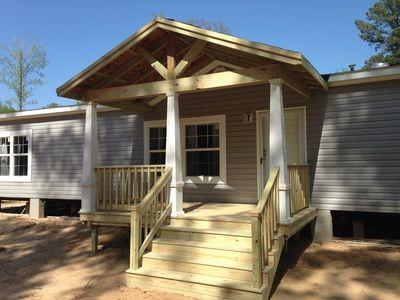 Gabled porch roof with craftsman-like columns for a manufactured home via Sunset DeckS.