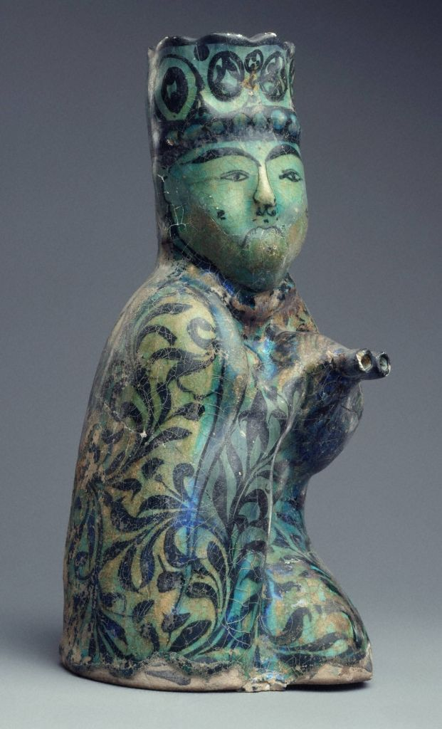 Molded vessel: seated man holding a water skin - Persian, Kashan, Esfahan, Iran - Second half of the 13th century