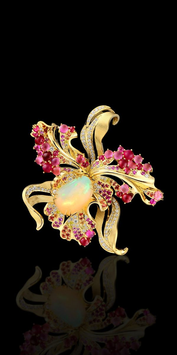 From the Diamond Flowers Collection:  18K yellow gold pendant/brooch with opal 4.7 carats, white and yellow diamonds, rubies, sapphires, and tourmalines.