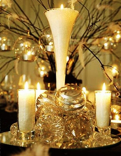 Wedding Candles - the use of the glass balls, mirrors, etc. is genius. Lots of crystal and glass with gold accents transforms an evening into something spectacular.
