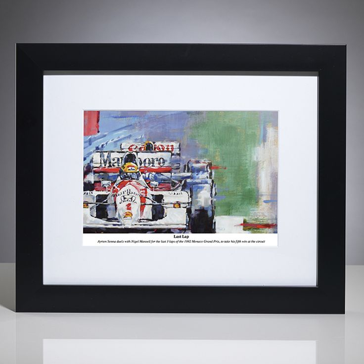 This limited edition F1 art print by British artist, Simon Canacott captures Senna at the legendary 1992 Monaco Grand Prix. He duelled with Nigel Mansell for the last 3 laps of the circuit; eventually taking his fifth win at the circuit.  Limited edition of 500 prints; signed and numbered by the artist. Framed by our professional framing team with a matt black frame and white conservation-grade mount board, protected with Perspex art screen.  Unframed print measures 36cm x 28cm (14 x 11 ...