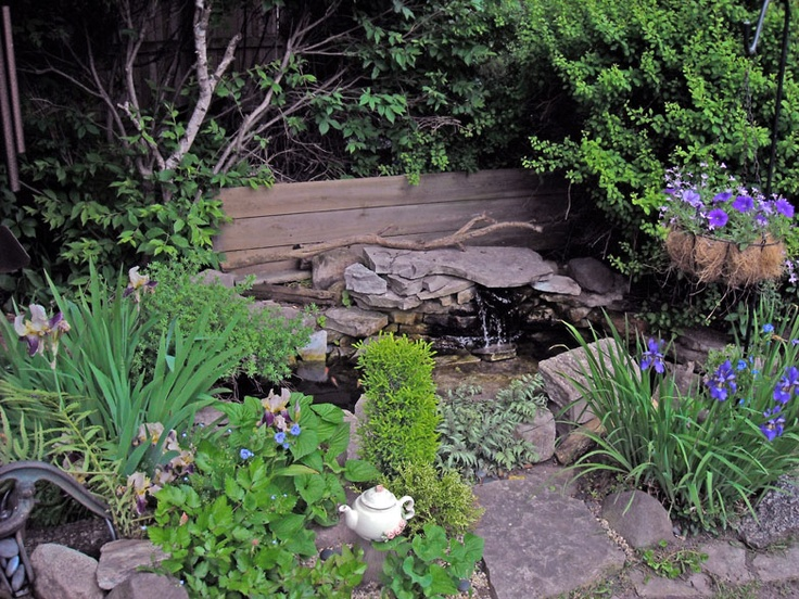 I've had this small garden pond for 20 years. Birds love bathing in the little waterfall. Goldfish winter over in the pond with the help of an energy-efficient stock tank heater.