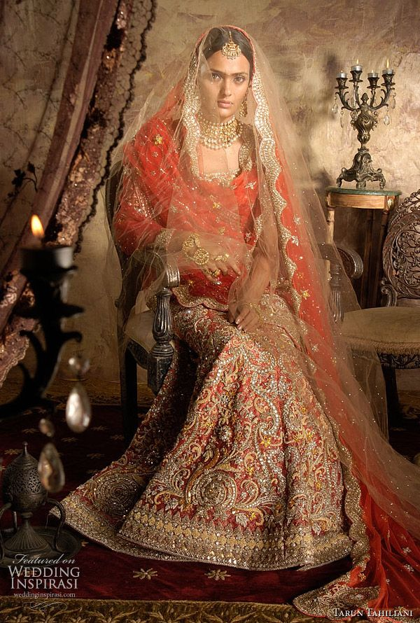 red bridal lehenga in muted brocade base with traditional gold zardozi thread and wire embroidery by http://www.TarunTahiliani.com/index.html