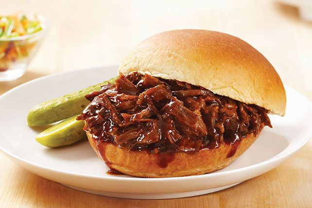 Boneless beef chuck roast gets falling-off-the-bone tender (so to speak) in this easy slow-cooker BBQ dish. Serve in buns and make seven people happy!