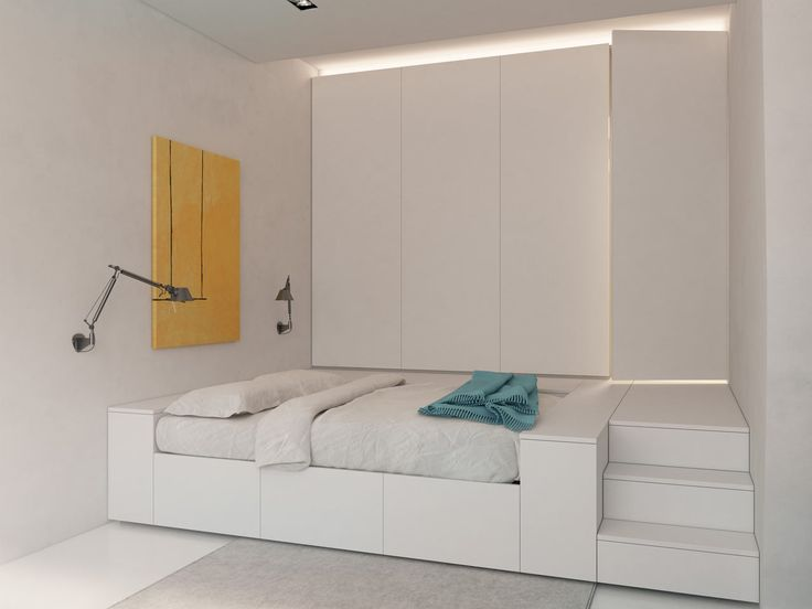 http://design-milk.com/transformer-apartment-vlad-mishin/transformer-apartment-vlad-mishin-6/                                                  The built-in bed has a closet above that you reach via the stairs. You also can access the bathroom this way.