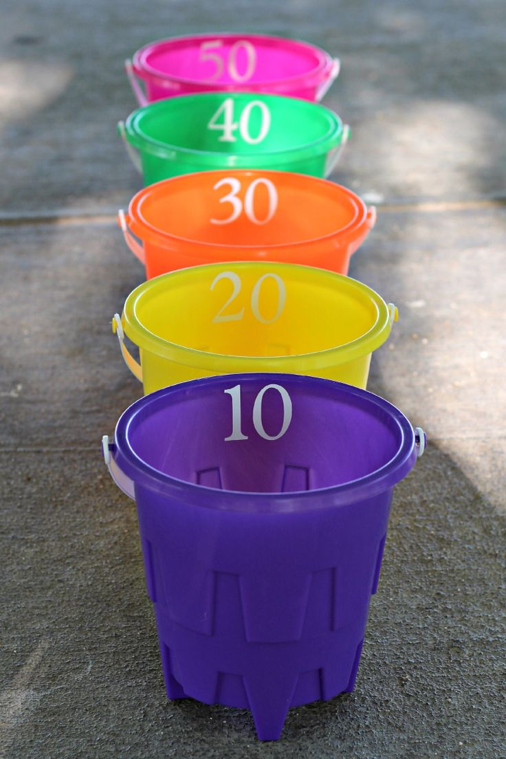 Bucket Ball Toss – you will need 5 buckets, 3 soft balls, and sticky numbers. I used my vinyl cutter to make numbers for each bucket, you could also use sticky letters. Cost – $6