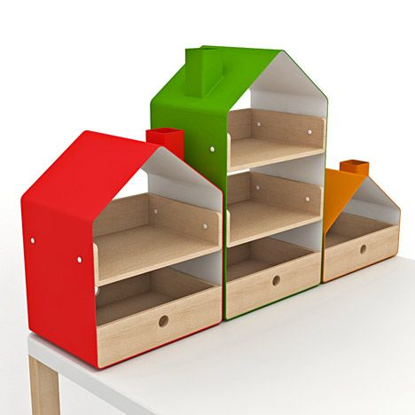 Desk-tidier designed in the shape of a gabled house.