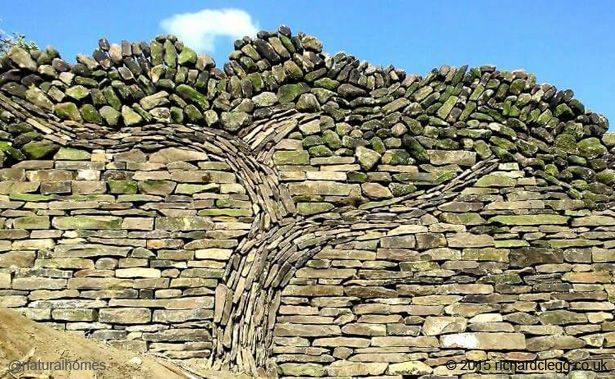 This is a small part of a much larger dry stone wall inspired by Vincent Van Gogh and built by Richard and Lewyn Clegg. More at www.naturalhomes.org/timeline/the-stone-tree.htm