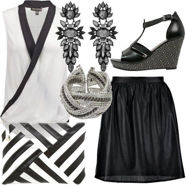 Ecco un outfit che è una garanzia di stile .  Il bianco e nero è di grande tendenza anche in questa stagione , un classico che non delude mai .  Questo look fa subito sera anche grazie agli accessori super chic !!!