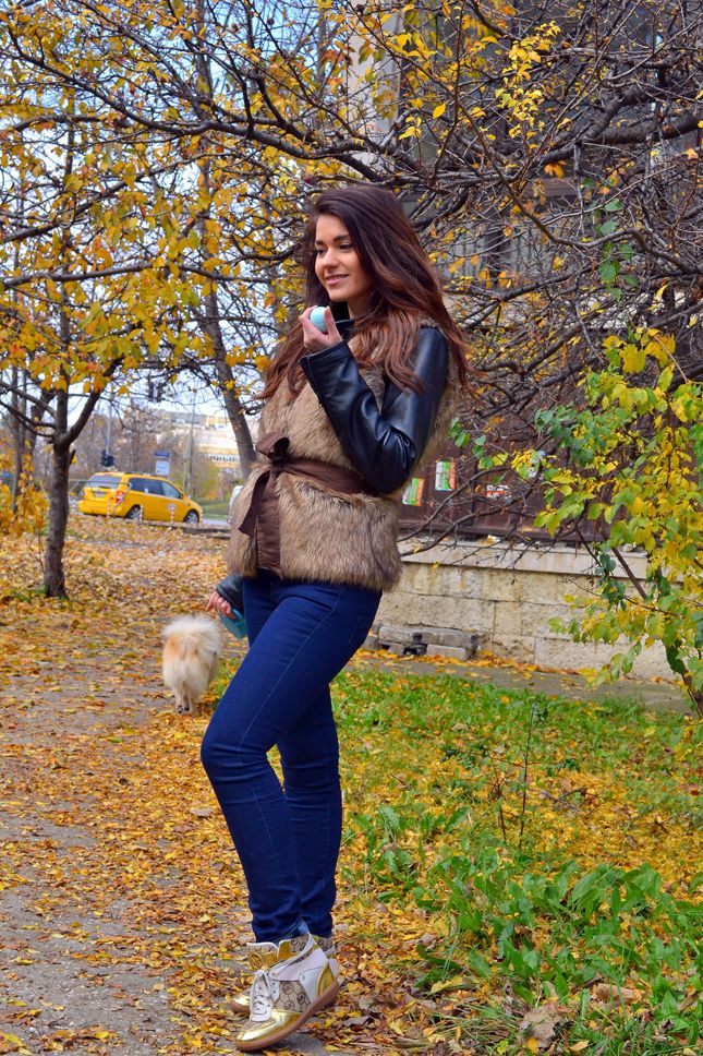 Pair a brown fur vest with dark blue skinny jeans for a comfortable outfit that's also put together nicely. Gold high top sneakers will add a new dimension to an otherwise classic look.  Shop this look for $136:  http://lookastic.com/women/looks/brown-vest-black-jacket-navy-skinny-jeans-gold-high-top-sneakers/6175  — Brown Fur Vest  — Black Leather Jacket  — Navy Skinny Jeans  — Gold High Top Sneakers