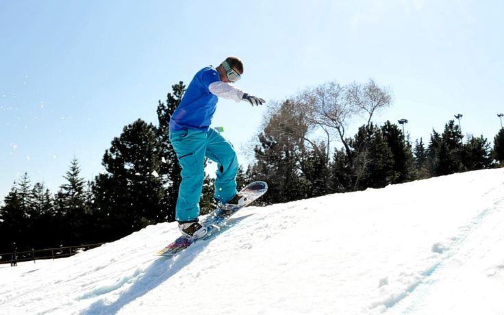 A snowboarder enjoying the slopes at Centennial Park
