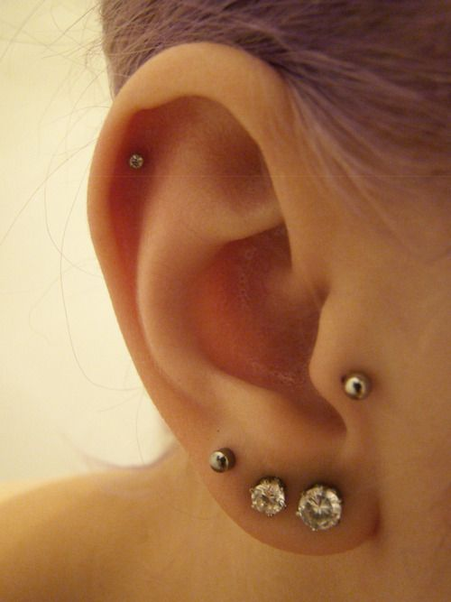 Ear Piercings - these are the exact piercings I have on my right ear! I love her earrings