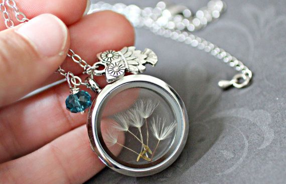 A family of floating dandelion seeds ready to receive your secret wishes, enclosed within this stunning clear glass floating locket ♥