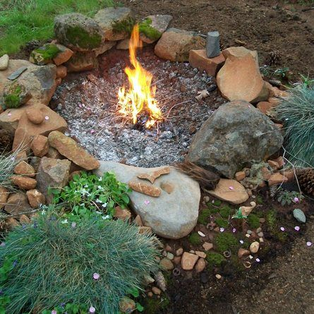 Using only natural resources available on her property, this homeowner created a fire-pit garden using soaproot, violets, walnuts, Douglas Fir cones, pine cones, moss, blossoms, and interesting rocks to remind her of the Maidu Native Americans that once lived there.| thisoldhouse.com/yourTOH