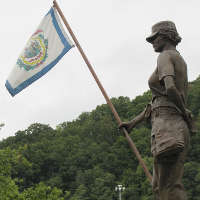 Women in Vietnam memorial statue at the WV State Capital complex. She's flying the WV state flag.
