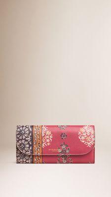 Cartera continental de piel con estampado floral