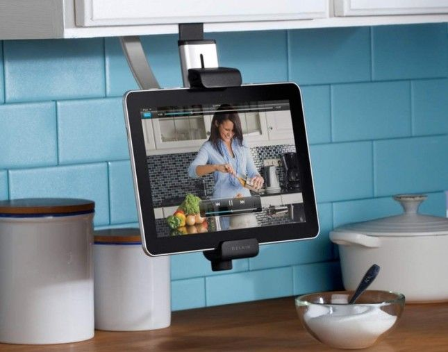 This tablet stand mounts to the underside of a  kitchen cabinet, so it's closer to eye level.