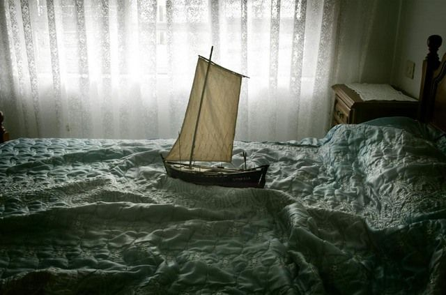 "For his project titled ""Ara Solis"", Guatemalan phot  ographer Luis González Palma created a series of images representing small models of 15th century sailing boats, symbolically 'crossing the seas' of different sleeping beds. Ideas of migration, intimacy and dreams of the future are brought about in this wonderful series."