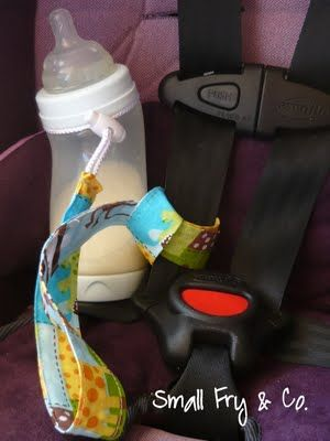 Ever try to find the sippy cup (or other drinking thing) when your kid has dropped it? Love this idea. Cord anchors to the car seat belt.
