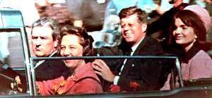"Riding thru the streets of Dallas in their open top limousine with the President and First Lady were Texas Governor John Connally and his wife, Nellie. Mrs. Connally turned to the President as the formation of cars turned onto Elm Street and said, ""Mr. President, you certainly cannot say that Dallas does not love you."" He smiled and then there was a loud noise."