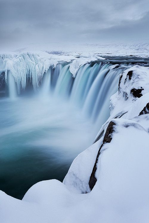 Wintry Godafoss, Iceland, The Goðafoss is one of the most spectacular waterfalls in Iceland. It is located in the Mývatn district of North-Central Iceland at the beginning of the Sprengisandur highland road