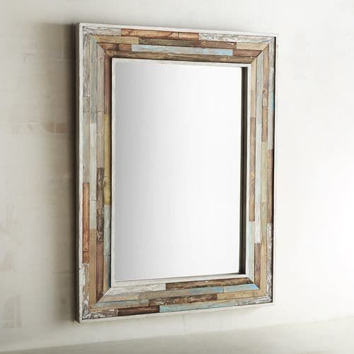 Here's a mirror that checks the box of the hottest trends in home design. We can see it working equally well in a farmhouse chic setting, industrial, Southwestern-inspired, coastal and even modern. It has the look of reclaimed wood in a range of natural color variations inlaid with care, resulting in a true statement piece you'll be proud to own.