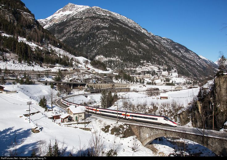 Since change of timetable in december 2014, one pair of Eurocity between Zürich and Milan is run again with highspeed tilting train of the ETR 610 series. Train EC 17 with ETR 610 # 010 is passing Wassen on the Gotthard north ramp, crossing the Reuss river on the lower Wattinger bridge at Wassen, Switzerland by Georg Trüb.
