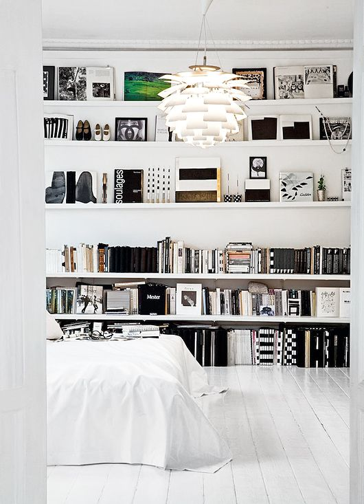 black and white and bookshelves all over