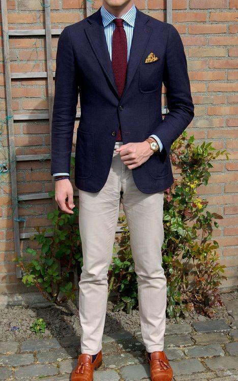 Navy sport coat, white shirt with blue dress stripes, burgundy knit tie, khakis