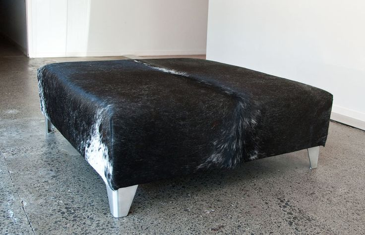 A modern black and white speckle cowhide ottoman by Gorgeous Creatures who are a cowhide ottoman and leather decor specialists. www.gorgeouscreatures.co.nz or www.cowhideottoman.com.au