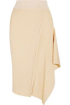 Stella McCartney Asymmetric ribbed stretch-jersey midi skirt | NET-A-PORTER  Stella McCartney's Spring '15 runway was filled with effortless, fluid silhouettes. This asymmetric beige midi skirt is crafted with panels of ribbed stretch-jersey that have been pieced together to create a layered effect. Style yours with a tonal top and accessories.  Beige stretch-jersey Pull on 93% rayon, 7% polyester; trim: 81% rayon, 18% polyamide, 1% elastane Dry clean Designer color: Butter/ Creme
