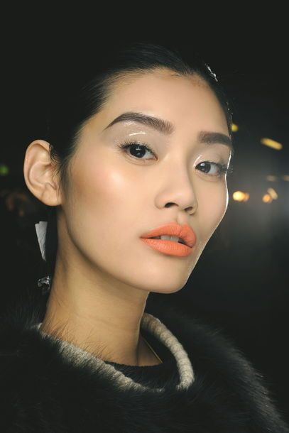 glossy eye makeup: Put transparent Lipgloss on your eye Lid and then apply the eyeshadow